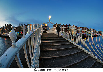 Ha`penny bridge in Dublin - Ha`penny bridge and river Liffey...