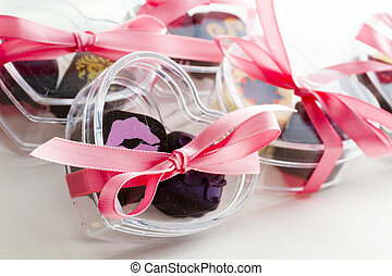 Wedding favors - Miniature hear shaped boxes filled with...