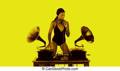 sexy young woman djs using two retro antique gramophones...