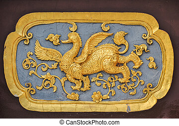 Kirin carved gold paint