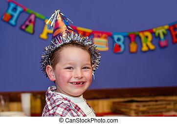Child enjoying his birthday party - Portrait of child...