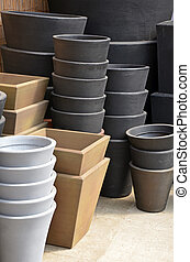 Stacks of garden planters - Stacks of assorted planters in...