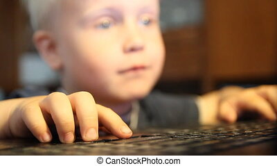 A boy plays in the computer. home f