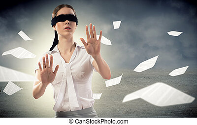 young blindfolded woman. can not find a way out