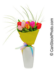 Flower bouquet from colorful tulips in white vase isolated...