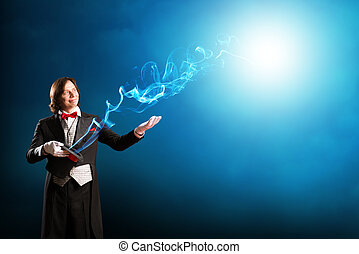 magician holding a cylinder where the magic fly