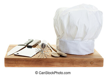 chef's tools - A chef's toque with various cooking utensils...