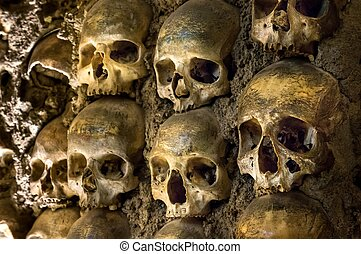 Wall full of skulls and bones in the bone chapel in Evora,...