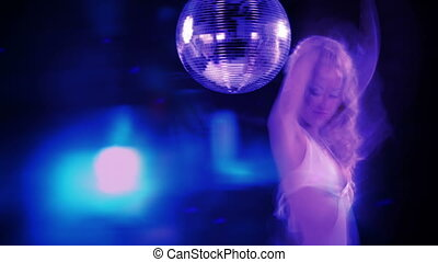 sexy professional gogo lily malibu shot dancing and next to a large spinning discoball