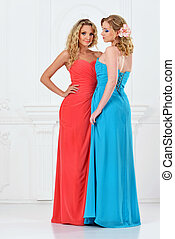 Two beautiful women in evening dresses