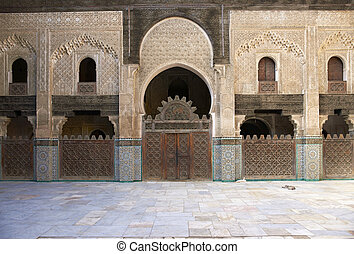 Bou Inania Madrasa - Ornate carving on the plastered walls...