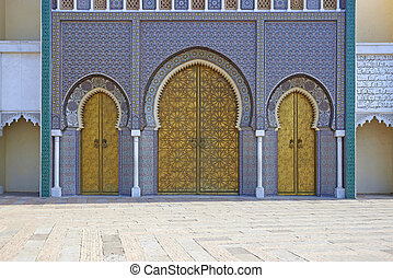 Royal Palace - Ornate entrance gates to the Royal Palace in...