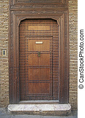 Studded Door - Studded wooden door to a historic Riad in the...