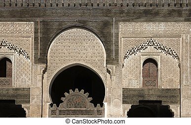 Ancient Islamic School - Ornate carving on the plastered...