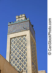 Ancient Minaret - Minaret decorated with a mozaic of blue...