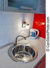 Kitchen Sink - A round stainless steel sink in the kitchen