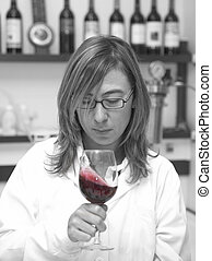 Taster professional working into a cellar laboratory Spain...