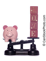 Cost of divorce - piggy bank and love letters on weighing...