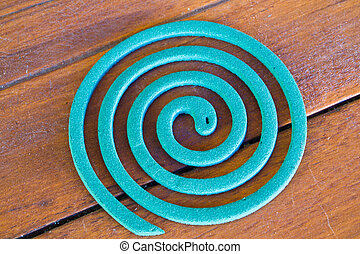 Mosquito coil on wooden background - pic of Mosquito coil on...