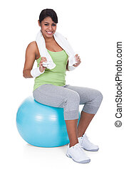 Woman Sitting On Pilates Ball Over White Background