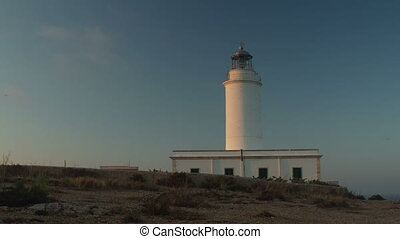 timelapse of the la mola lighthouse in formentera at sunset