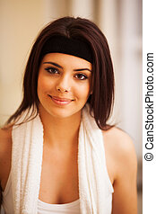 Portrait of a young beautiful sport woman with towel