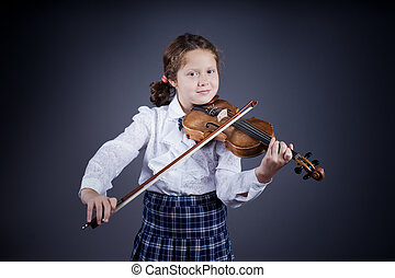 Beautiful girl playing the old violin on dark background