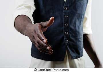 African American business man with an open hand ready to...