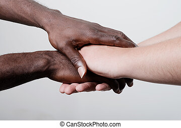 Closeup portrait of group with mixed race people with hands...