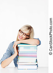 Caucasian Woman lying her head on the stack of books