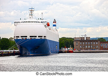 Car carrier ship - Large car carrier ship in port.