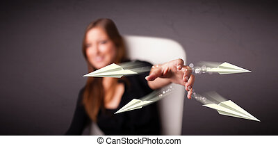 Beautiful lady throwing origami airplanes - Beautiful young...