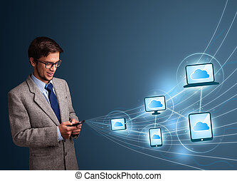 Handsome man typing on smartphone with cloud computing -...