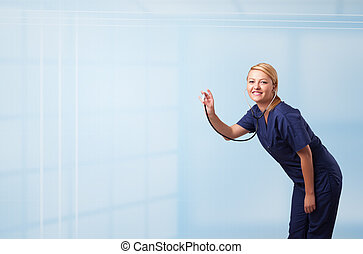 Pretty young nurse in hospital listening to empty copy space with sthetoscope