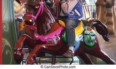 Fairground Carousel - Riding the carousel for young children...