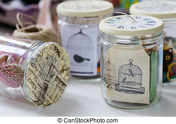 Glass jar containing various craft materials - scrapbooking...