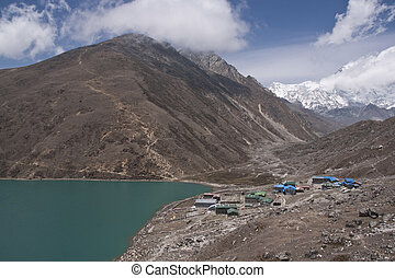 Gokyo Village - Mountains surrounding the clear blue waters...