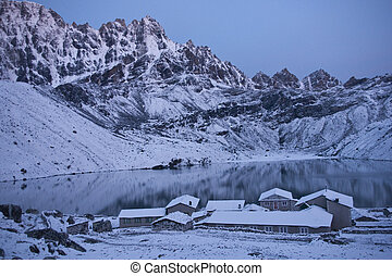 Gokyo Village at Dawn - Snow covered buildings in the...