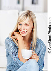 Woman relaxing with a cup of coffee - Beautiful long haired...