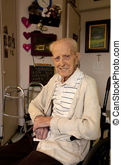 Senior Man Sitting in Wheel Chair in Care Facility - A...