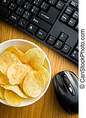 crispy potato chips on office table