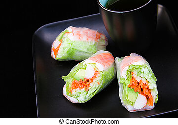Spring Rolls with Tea on Black