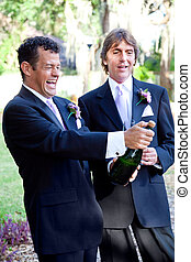 Gay Couple Opening Champagne - Handsome gay couple at their...
