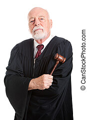 Stern Judge with Gavel - Stern judge holding his gavel,...