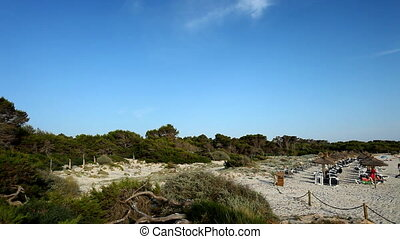 panning shot of beautiful beach scene in colonia sant jordi...