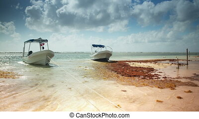 timelapse of small fishing boats moored in beautiful caribbean water