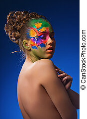 Portrait girl with fashionable make-up and flowers