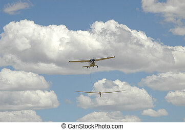 Aeroplane towing glider into the air at Tempe Airport near...