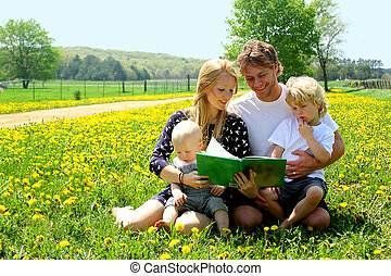 Family Outside Reading - A family of four, mother, father,...