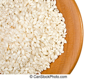 plate ov rice - rice in wood plate close up isolated on...